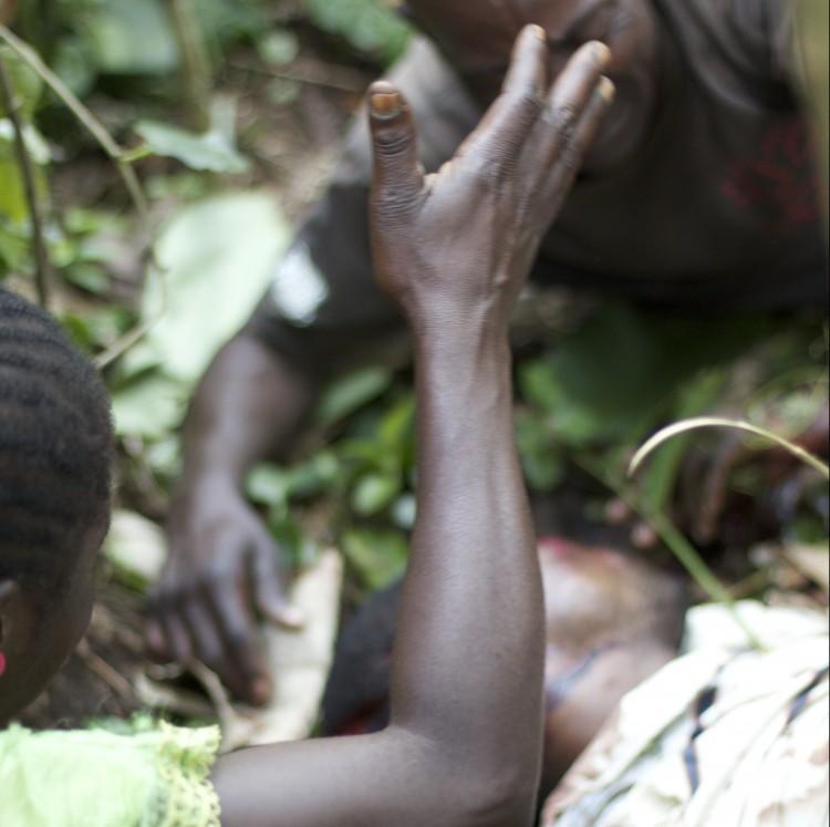 A family mourns a massacre victim in Mokoko, Ocotber 2014 (Photo: Dearbhla Glynn)